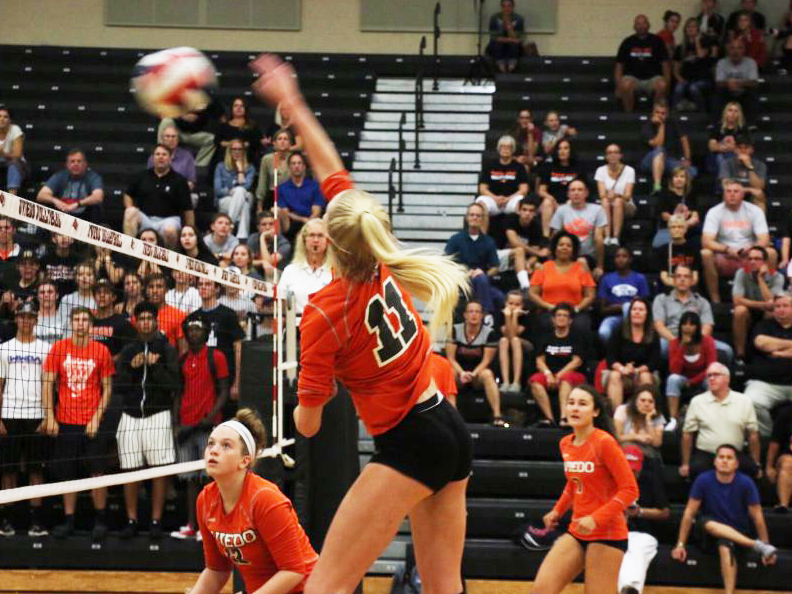 Sophomore Rileigh Powers goes for the kill against Lake Mary on Aug. 30 at RWL Gym. The Lions won the match.