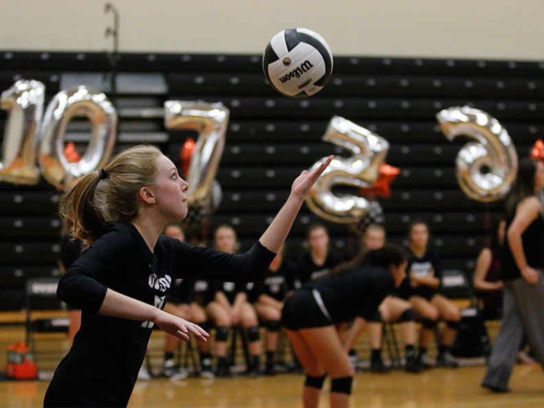 Junior Savannah Vach serves the ball on senior night against Winter Springs on Oct. 3 at the RWL gym.