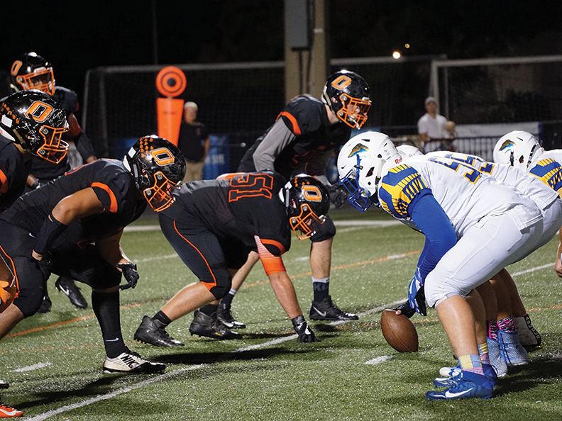 The defensive line, led by senior Jacob Kotar, lines up for a play in the Homecoming game against Lyman on Oct. 27 at John Courier Field. The Lions won 20-19.