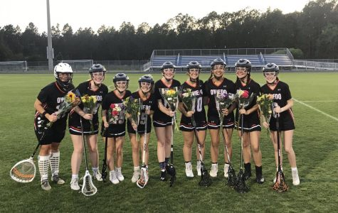 The senior players on the girls varsity lacrosse team pose for a picture at their makeshift senior night at Bartram Trail High School.