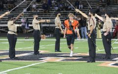 ROTC members form an entrance for senior Bryson Dunsworth at homecoming game.