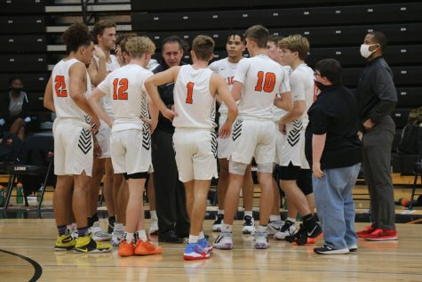 Coach Jason Vallery talks to his team in the huddle during a timeout in a hometown showdown against rivals Hagerty High School on Jan. 8.