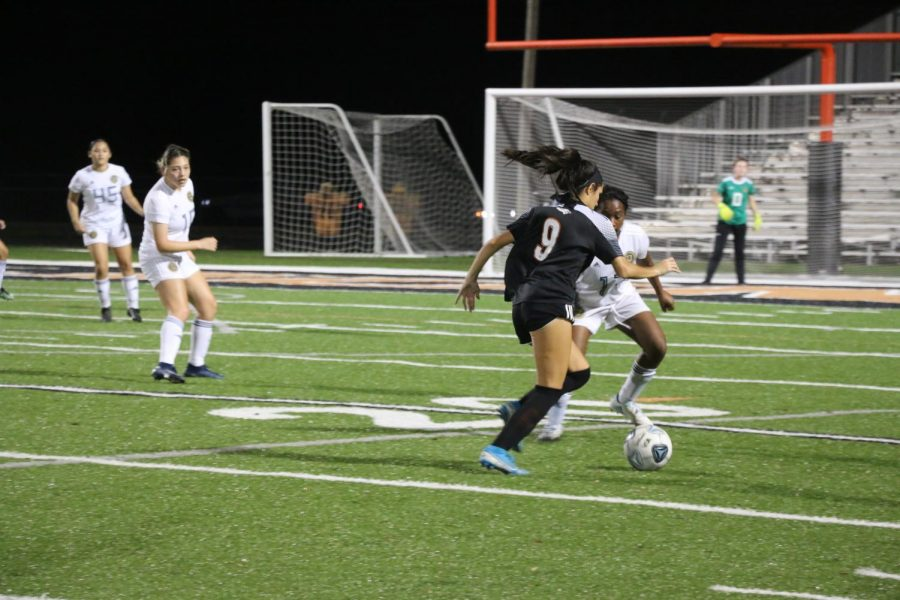 Senior Raisa Lugo tries to beat a defender vs. Wekiva on Jan. 29.